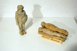 resized_Installation_3___6_sculptures___Concrete_and_wood___Palet_9_x_16_x_10_cm_Policeman_18_x_7_x_5_cm___2012